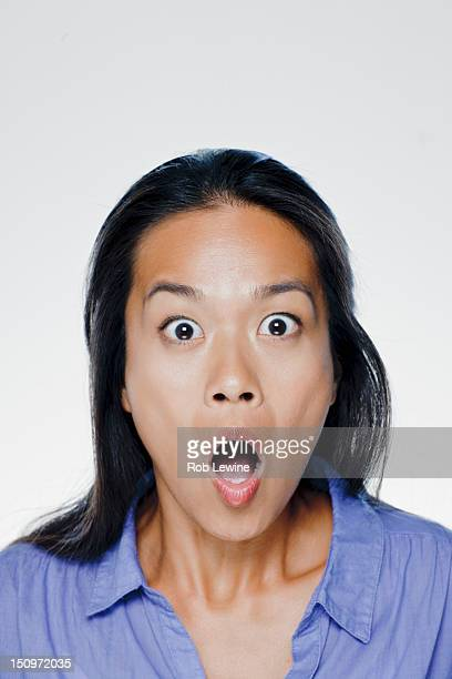 Portrait of surprised young woman, studio shot