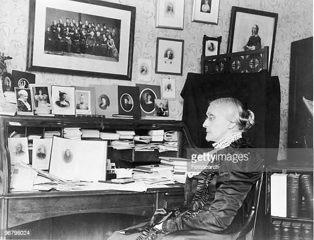 Portrait of Susan B Anthony sitting at a desk circa 1868