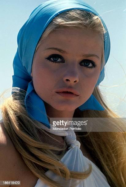 Portrait of Swedish actress Ewa Aulin wearing a blue headscarf 1970s