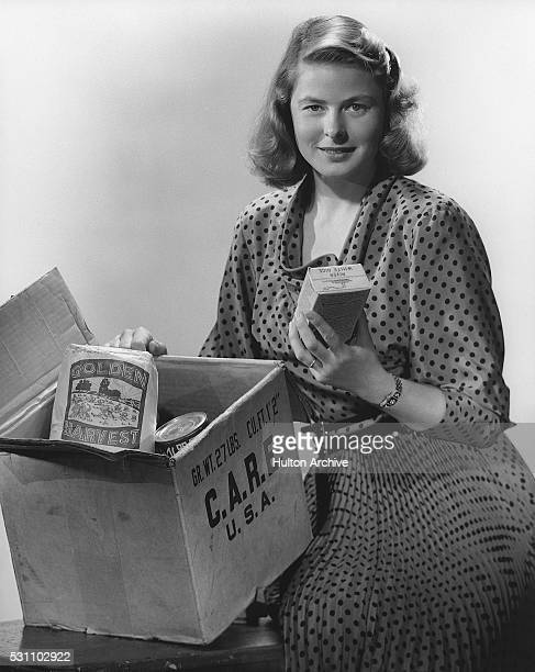 Portrait of Swedish actress Ingrid Bergman as she poses with a CARE package 1940s or 1950s CARE was a humanitarian agency its acronym later changed...