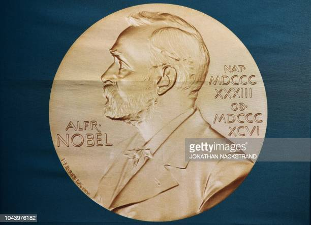 A portrait of Swedish inventor and scholar Alfred Nobel can be seen on a banner on display at the Nobel Forum in Stockholm Sweden prior to a press...