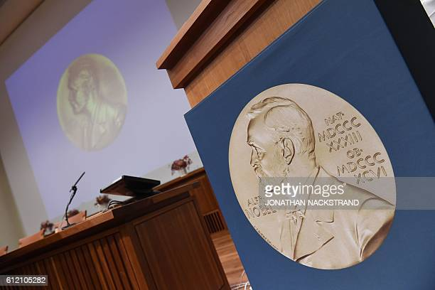 A portrait of Swedish inventor and scholar Alfred Nobel can be seen on the speaker's desk at the Nobel Forum in Stockholm prior to the announcement...