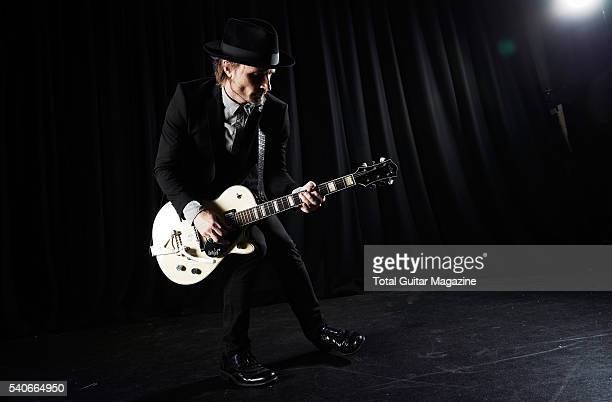 Portrait of Swedish musician Nalle Colt guitarist with blues rock group Vintage Trouble photographed before a live performance at 229 Venue in London...