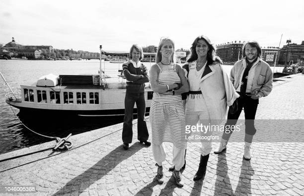 Portrait of Swedish Pop group ABBA as they pose dockside in Gamla Stan Stockholm Sweden July 1977 Pictured are from left Bjorn Ulvaeus Agnetha...