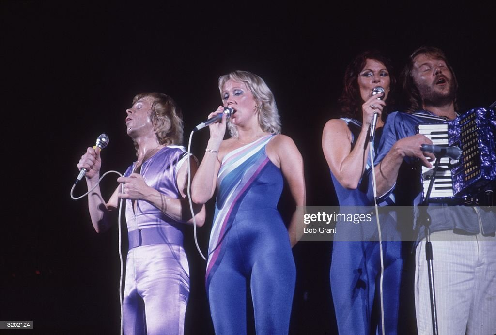 a portrait of swedish pop group abba performing in spandex