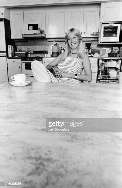 Portrait of Swedish Pop musician Agnetha Faltskog of the group ABBA as she sits behind a table in her kitchen Stockholm Sweden July 1977