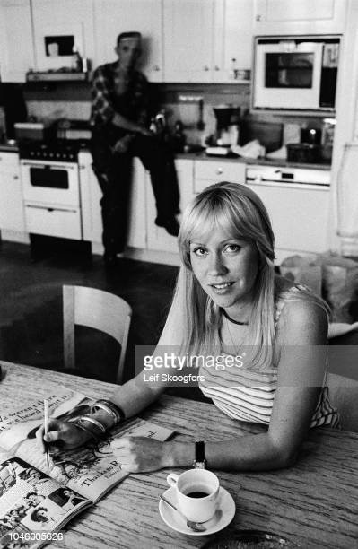Portrait of Swedish Pop musician Agnetha Faltskog, of the group ABBA, as she sits at table in her kitchen, Stockholm, Sweden, July 1977. The workman...