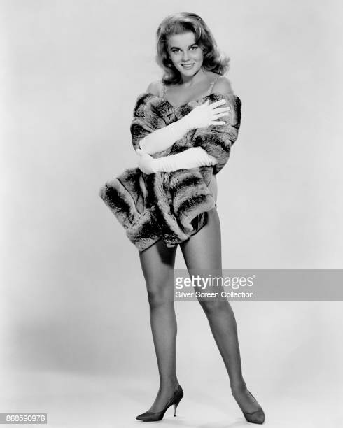Portrait of SwedishAmerican actress AnnMargret wrapped in fur as she poses in front of a white background for the film 'Once a Thief' San Francisco...