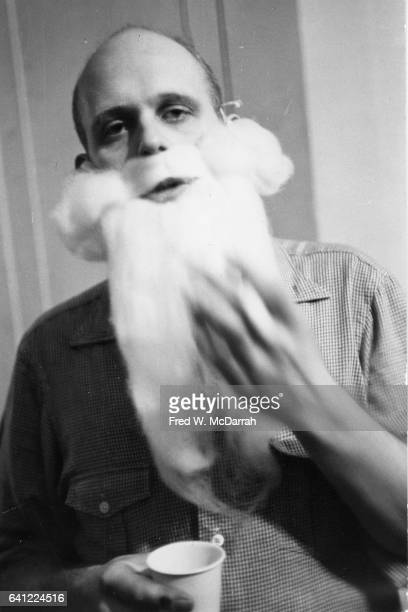Portrait of Swedishborn American Pop artist Claes Oldenburg with a false white beard as he prepares for a holiday show at the Filmmakers'...