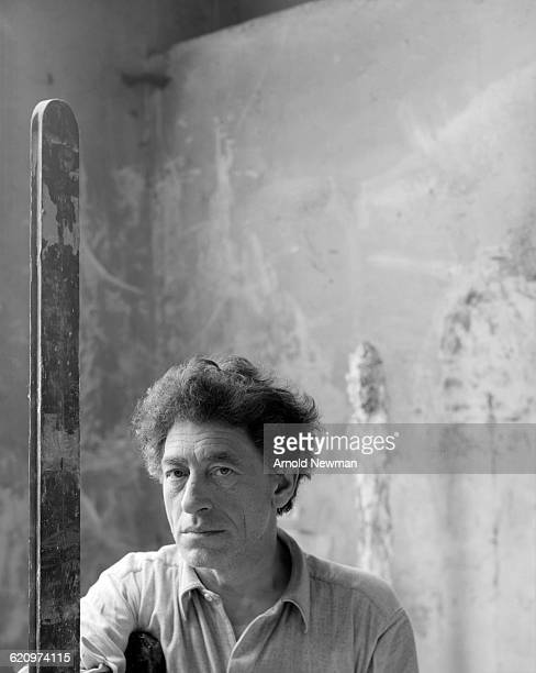 Portrait of Swiss artist Alberto Giacometti as he poses in his studio Paris France May 12 1954