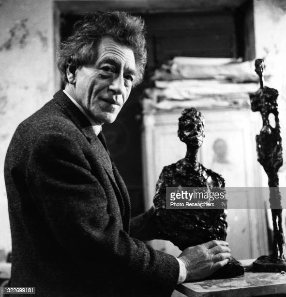 Portrait of Swiss artist Alberto Giacometti as he works on a sculpture in his studio, Paris, France, 1966.