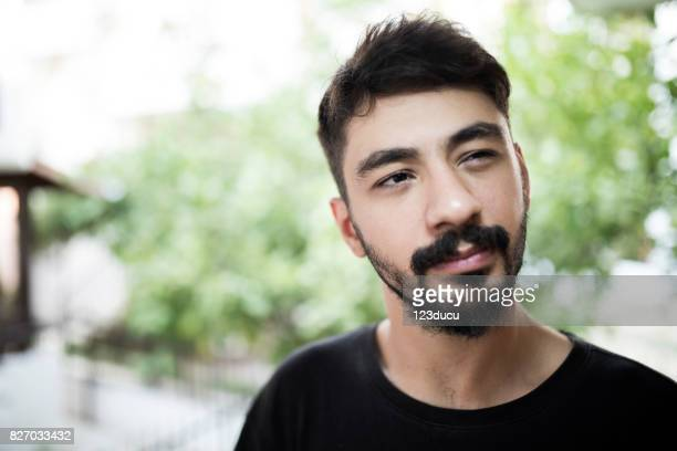 portrait of syrian young man - ugly turkey stock photos and pictures