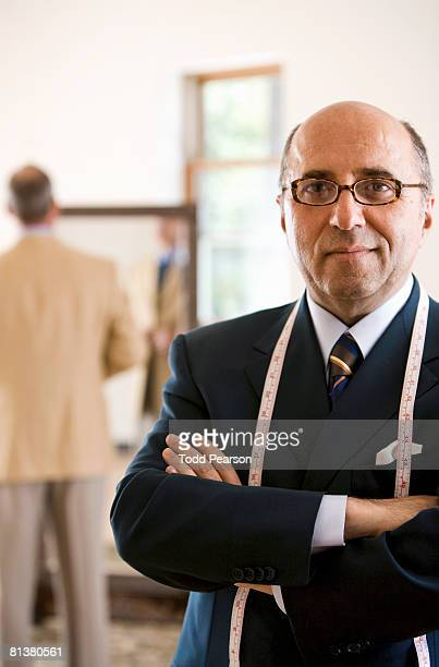 Portrait of tailor in dark suit