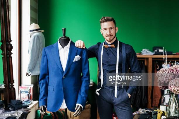portrait of tailor standing by manikin - figura maschile foto e immagini stock