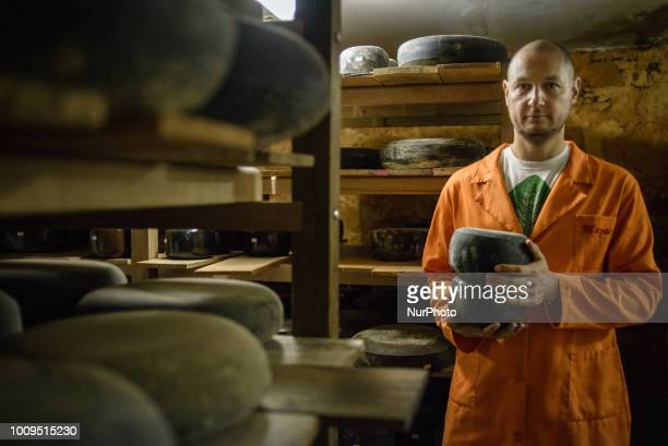 Portrait of Taras owner of the Dooobra ferma farm in a cellar full of ripening cheeses Dooobra ferma is a dairy farm in Kiev region specialized on...