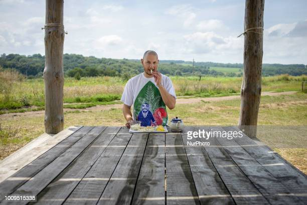 Portrait of Taras owner of the Dooobra ferma farm with the cheeses the farm produce Dooobra ferma is a dairy farm in Kiev region specialized on...