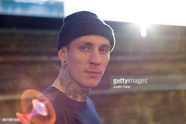 portrait of tattoed man shot from behind - tattoo stock pictures, royalty-free photos & images