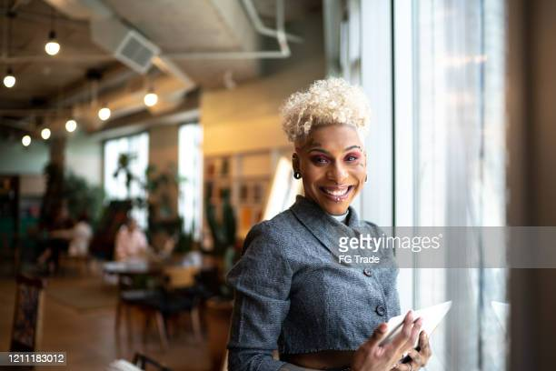 portrait of tattooed businesswoman using digital tablet at office - alternative lifestyle stock pictures, royalty-free photos & images