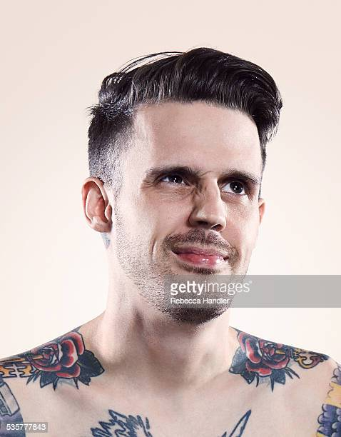 Portrait of Tattooed Nude Male making funny face