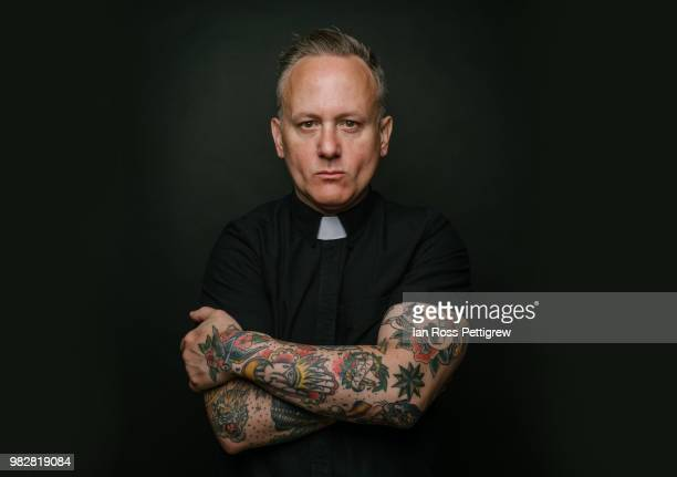 portrait of tattooed priest