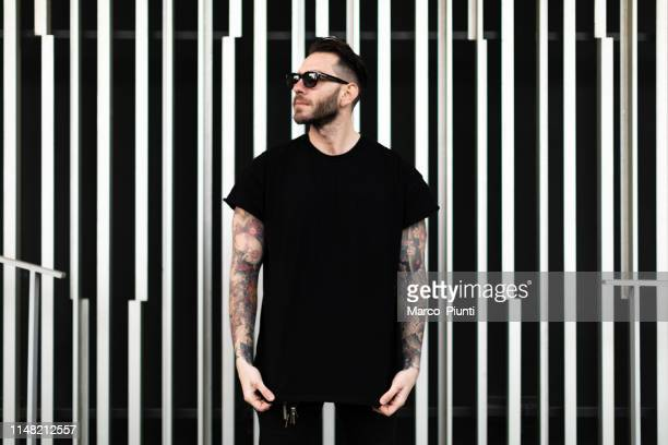 portrait of tattooed young man - punk person stock pictures, royalty-free photos & images
