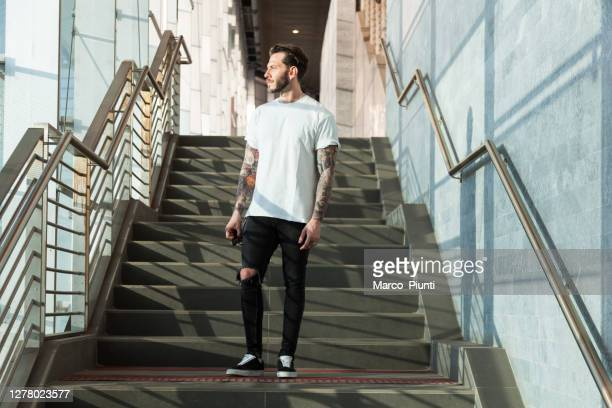 portrait of tattooed young man - white t shirt stock pictures, royalty-free photos & images