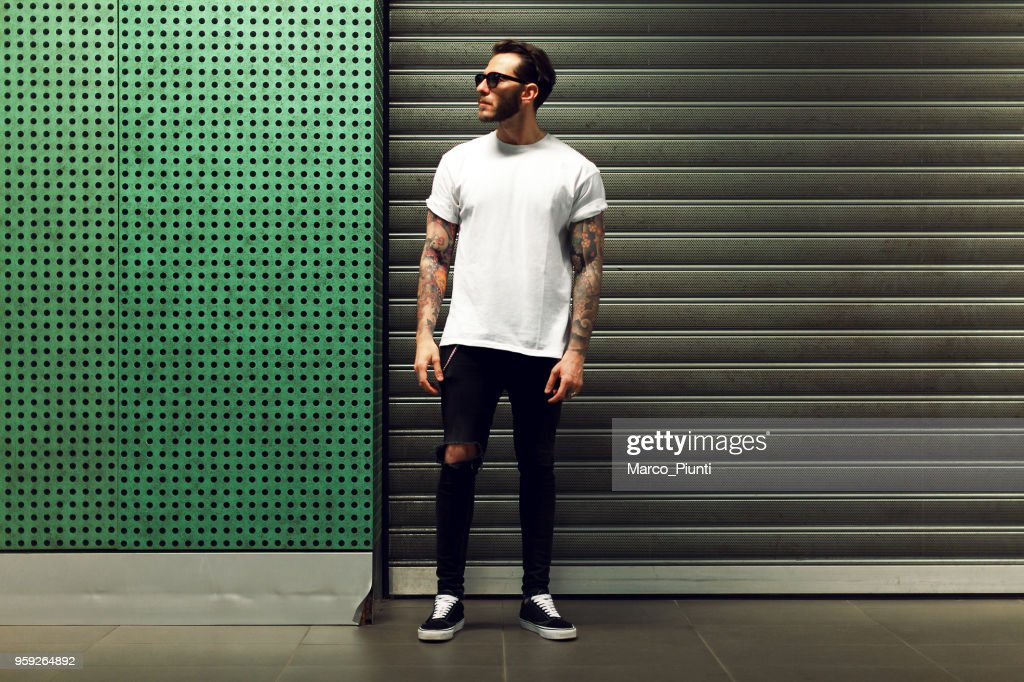 Portrait of tattooed young man : Stock Photo