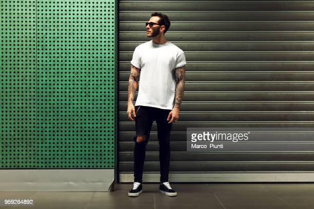 portrait of tattooed young man - all shirts stock pictures, royalty-free photos & images