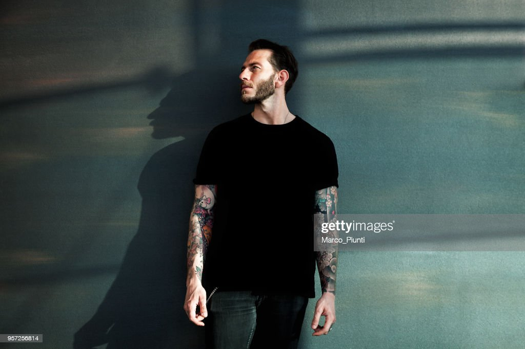 Portrait of tattooed young man with black t-shirt : Stock Photo