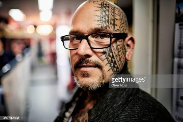 Portrait of tattooist in his studio