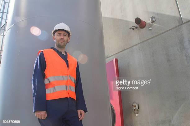 Portrait of technician outside power station