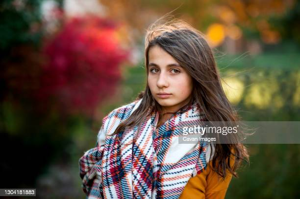 portrait of teen girl 11-13 years old in warm clothes on fall day - 12 13 years stock pictures, royalty-free photos & images