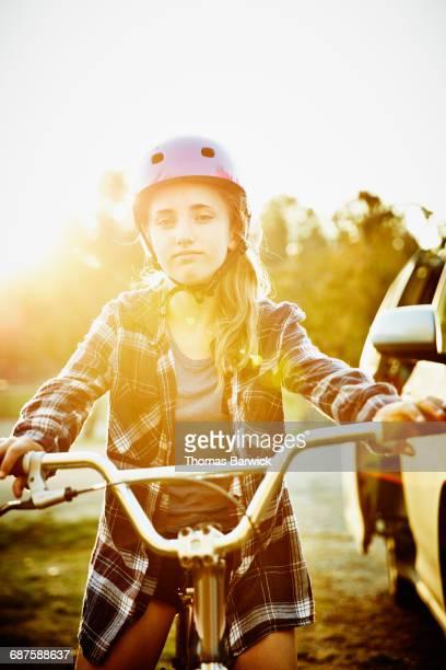 Portrait of teen girl on BMX bike