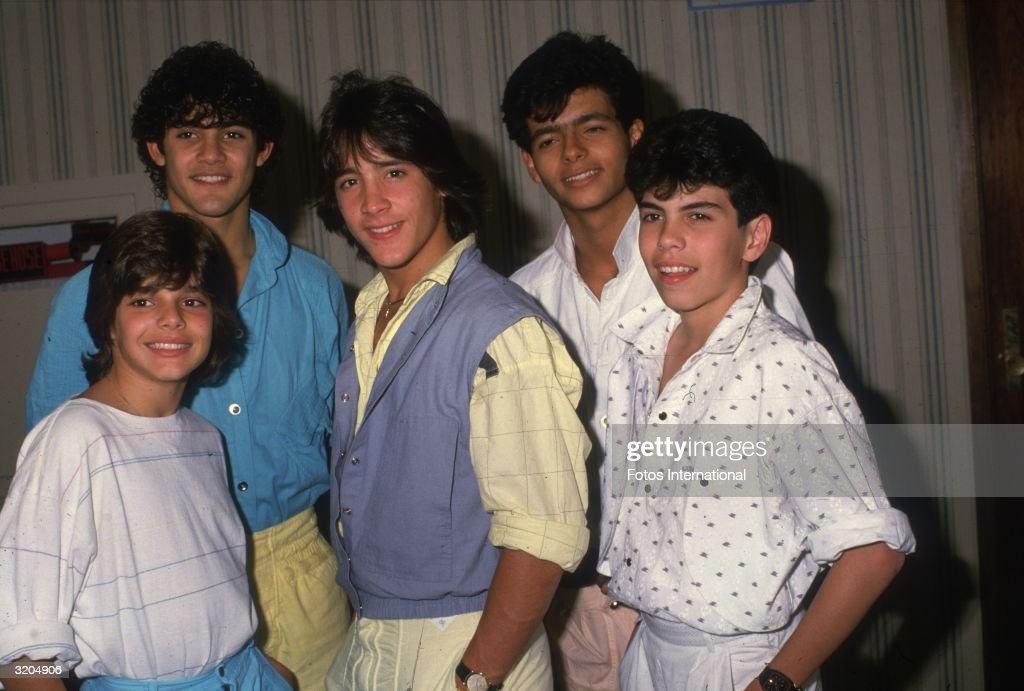 Ricky Martin, aged thirteen, Charlie Rivera, Roy Rossello, Robby Rosa, and Ray Acevedo) posing in a hallway at the Century Plaza Hotel, Los Angeles, California.