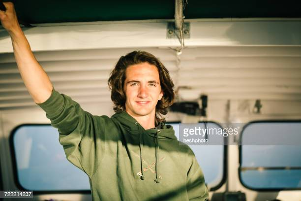 portrait of teenage boy in fishing boat on coast of maine, usa - heshphoto stock pictures, royalty-free photos & images