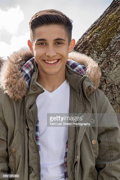 portrait of teenage boy in parka jacket - parka coat stock photos and pictures