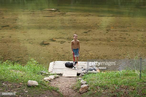 Portrait of teenage boy standing on pier, Canton, North Carolina, USA