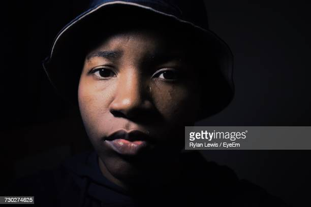 portrait of teenage boy wearing hat in darkroom - manchester england stock-fotos und bilder