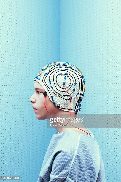 Portrait of teenage boy with brain test cap