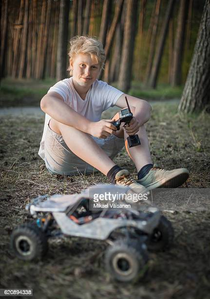 portrait of teenage boy with his remote controlled car - remote controlled car stock pictures, royalty-free photos & images