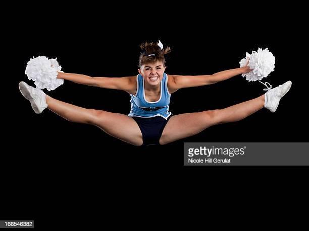 portrait of teenage cheerleader girl (16-17) with legs apart - teen cheerleader stock photos and pictures