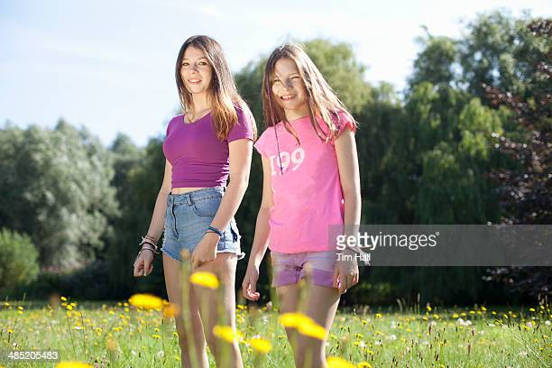 Portrait of teenage girl and her sister in park