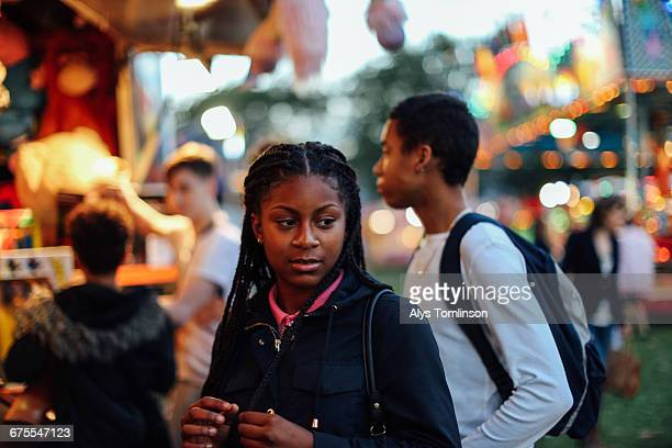 portrait of teenage girl at the fairground - looking away stock pictures, royalty-free photos & images