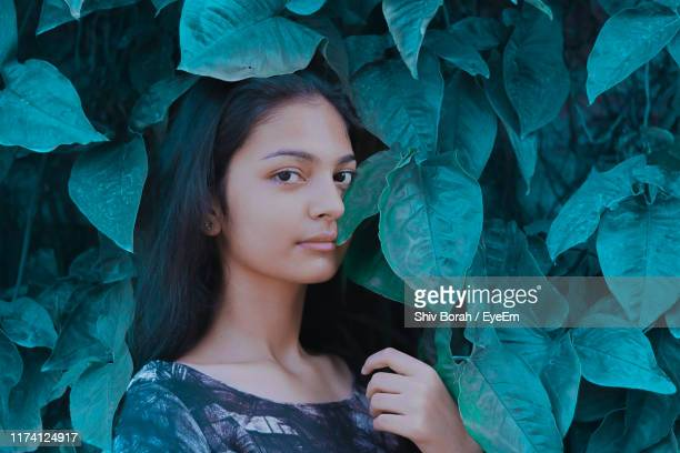 portrait of teenage girl by leaves - one teenage girl only stock pictures, royalty-free photos & images