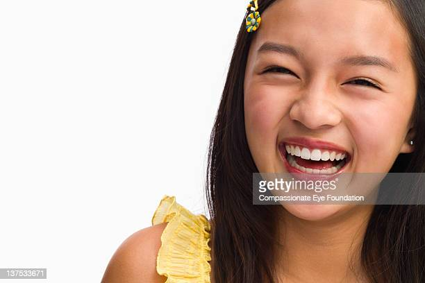 Portrait of teenage girl, close up, smiling