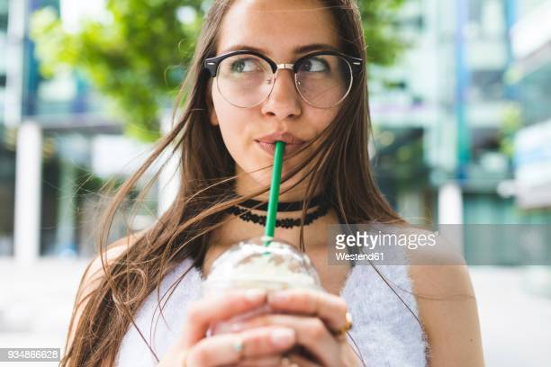 portrait of teenage girl drinking milkshake - milkshake imagens e fotografias de stock