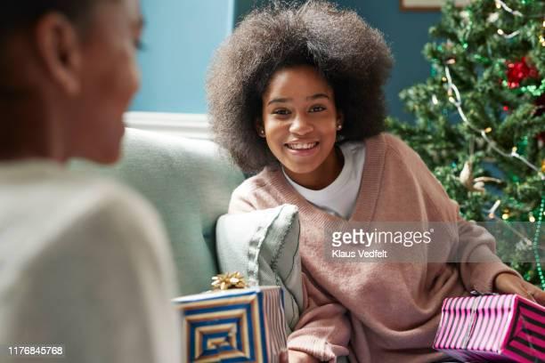 Portrait of teenage girl holding Christmas present