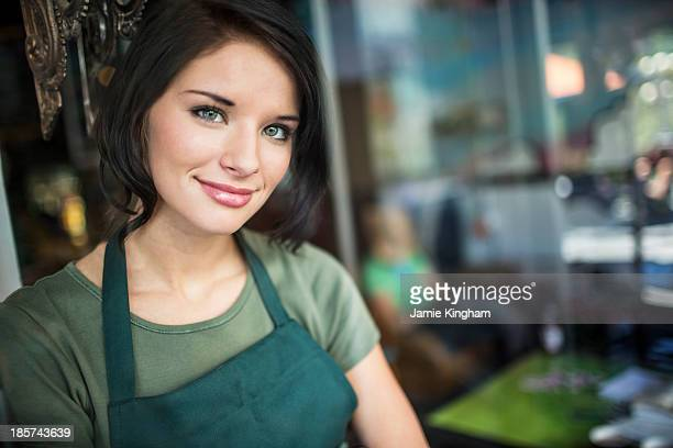 Portrait of teenage girl in cafe