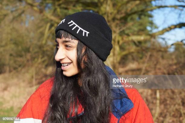 Portrait of teenage girl in countryside