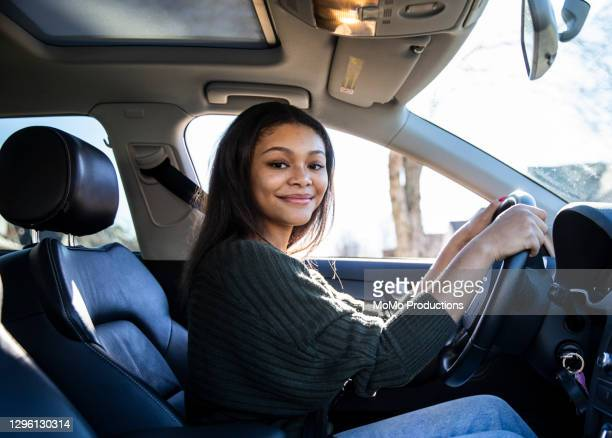 portrait of teenage girl in her first car - black trousers stock pictures, royalty-free photos & images
